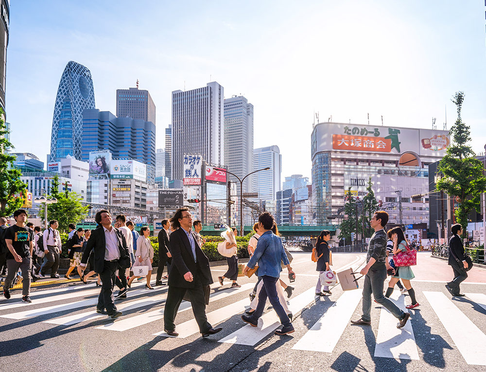 Crowded streets of Shinjuku shopping district with  commuters